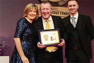 Jon Mellor with presenter Penny Smith at the 2013 Awards