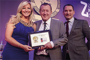 Jon Mellor with Michelle Mone baroness Mone OBE at the 2014 Awards